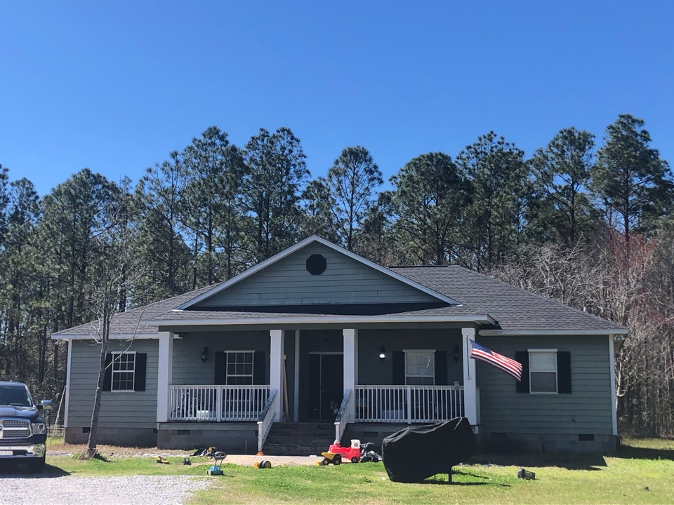 Long Beach, MS - B&M Roofing provided this gorgeous new roof using GAF lifetime series timberline architectural HDZ shingles in the bold color charcoal!