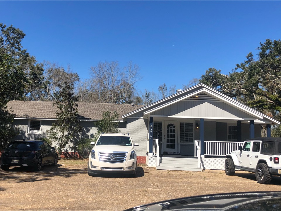 Long Beach, MS - B&M Roofing provided this office building with a brand new roof using GAF lifetime series timberline architectural HDZ shingles in the color weatherwood!