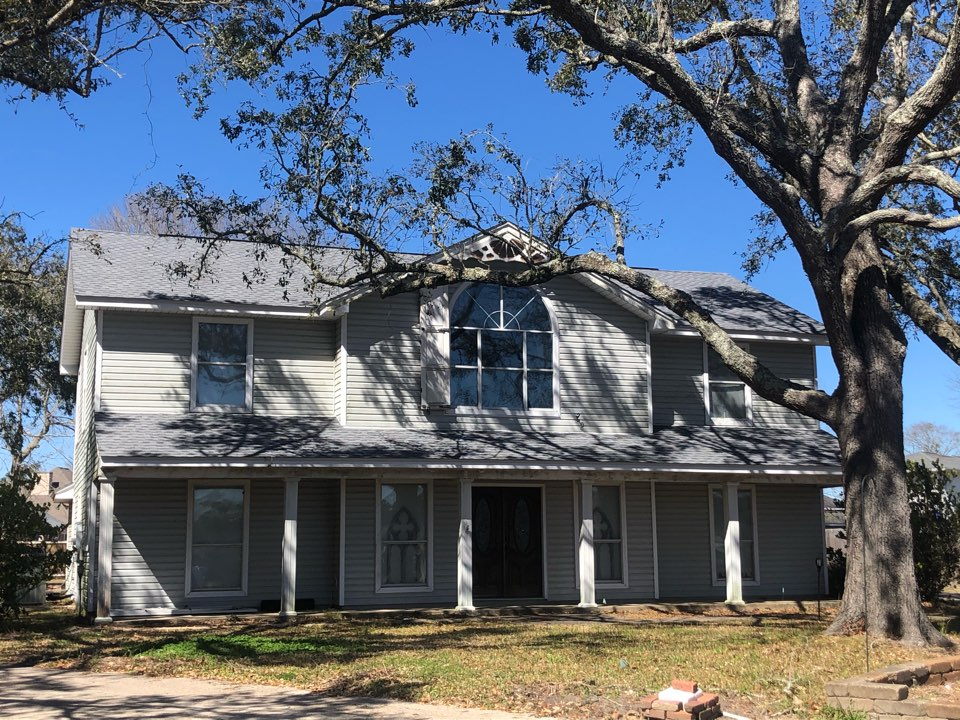 Long Beach, MS - This beautiful two story home too damage during Hurricane Zeta. B&M Roofing replaced this roof using GAF lifetime series timberline architectural HDZ shingles in the color Oyster Grey!