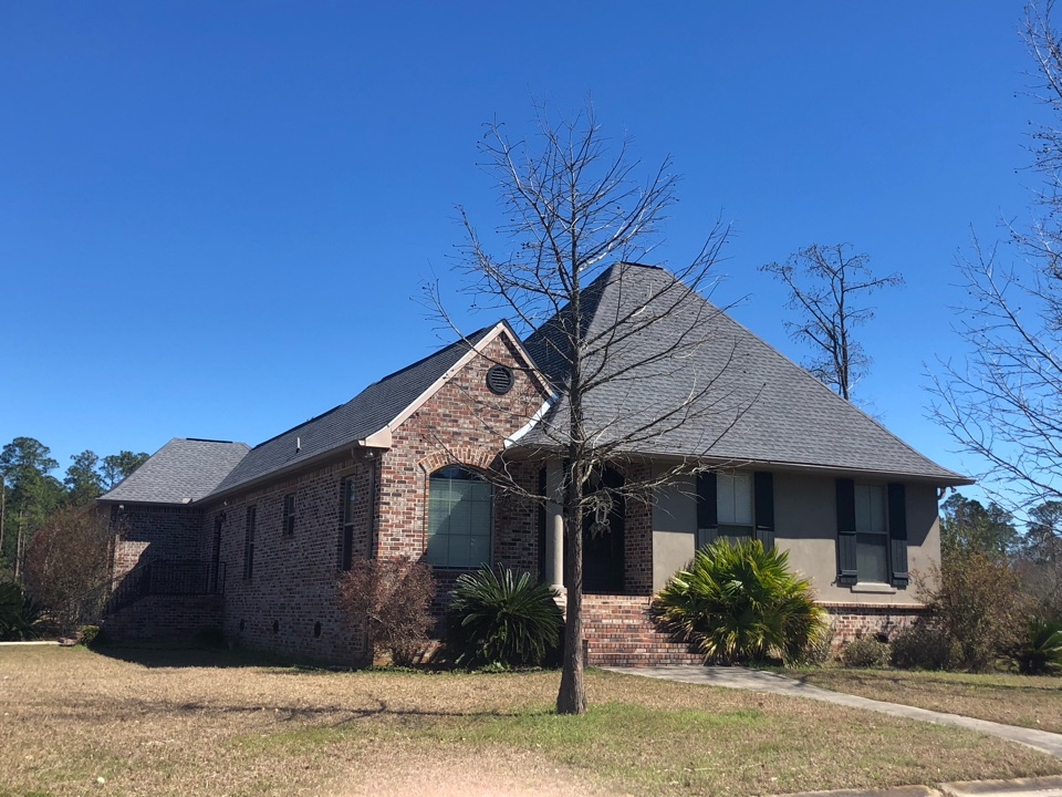Long Beach, MS - B&M Roofing provided this gorgeous one story home using GAF lifetime series timberline architectural HDZ shingles in the bright color Oyster Grey!