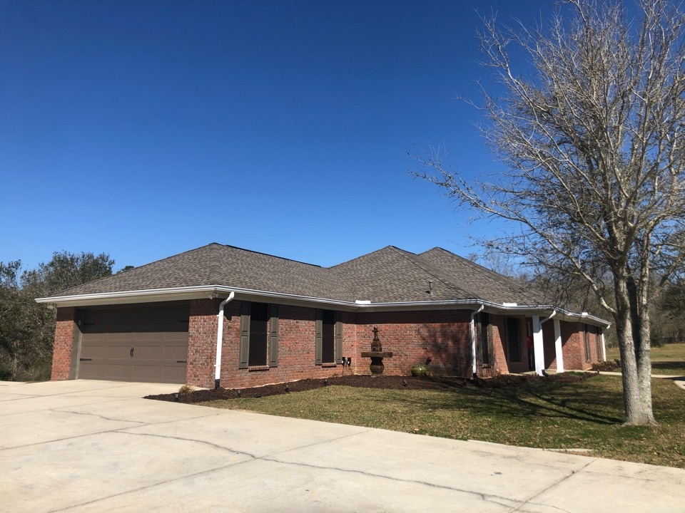 Pass Christian, MS - This gorgeous home took roof damage during Hurricane Zeta. B&M Roofing provided this family with a brand new roof using GAF lifetime series timberline architectural HDZ shingles in the color weatherwood!