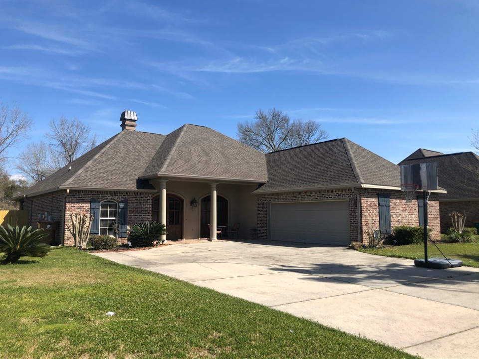 Long Beach, MS - This gorgeous home had roof damage during Hurricane Zeta B&M Roofing replaced this roof using GAF lifetime series timberline architectural HDZ shingles in the color weatherwood