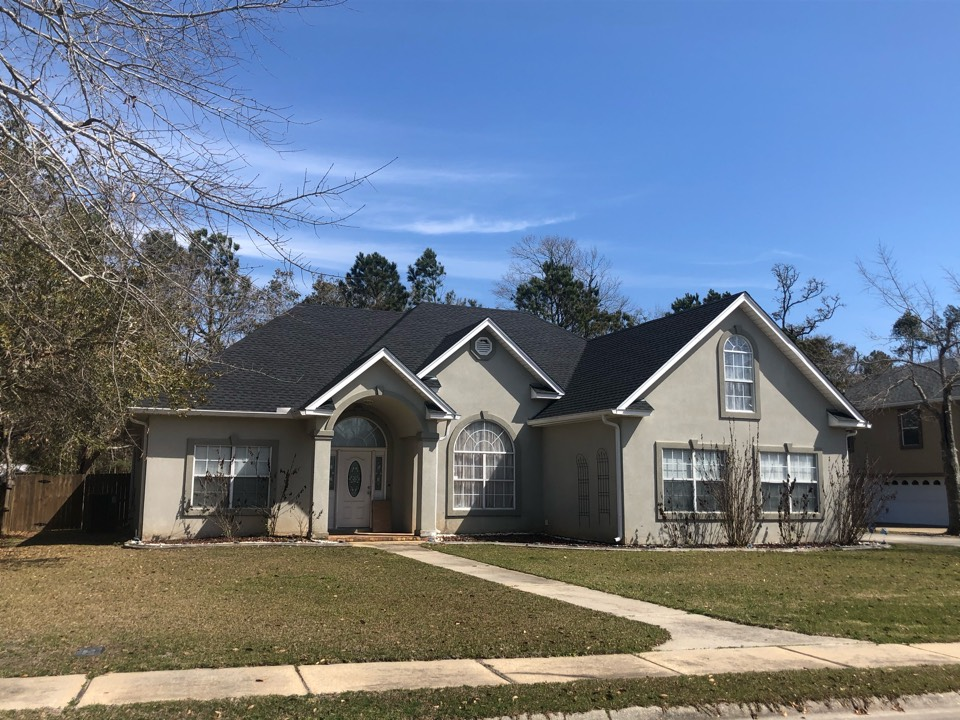 Bay St. Louis, MS - This beautiful one story home had their old three tab shingles replaced with GAF lifetime series timberline architectural HDZ shingles in the color charcoal by B&M Roofing.