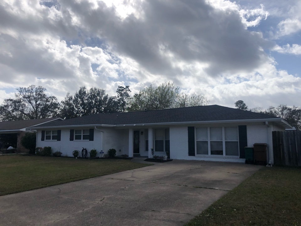 Biloxi, MS - This bright one story home took roof damage during Hurricane Zeta. B&M Roofing provided them with a brand new roof using GAF lifetime series timberline architectural HDZ shingles in the color charcoal