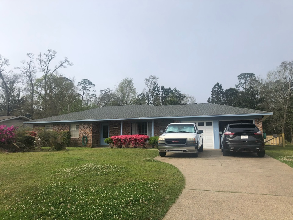 Long Beach, MS - This sweet one story home took roof damage during Hurricane Zeta. B&M Roofing provided them with a brand new roof using GAF lifetime series timberline architectural HDZ shingles in the color Oyster Grey.