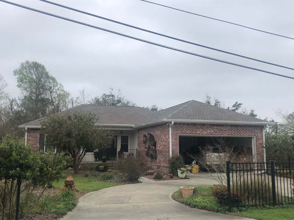 Long Beach, MS - This one story home took roof damage during Hurricane Zeta. B&M Roofing provided them with a brand new roof using GAF lifetime series timberline architectural HDZ shingles in the color weatherwood