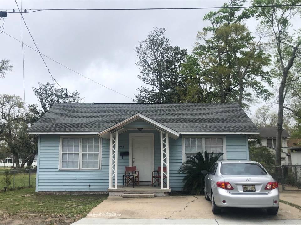 Biloxi, MS - This adorable one story home took roof damage during Hurricane Zeta. B&M Roofing provided them with a brand new roof using GAF lifetime series timberline architectural HDZ shingles in the color weatherwood