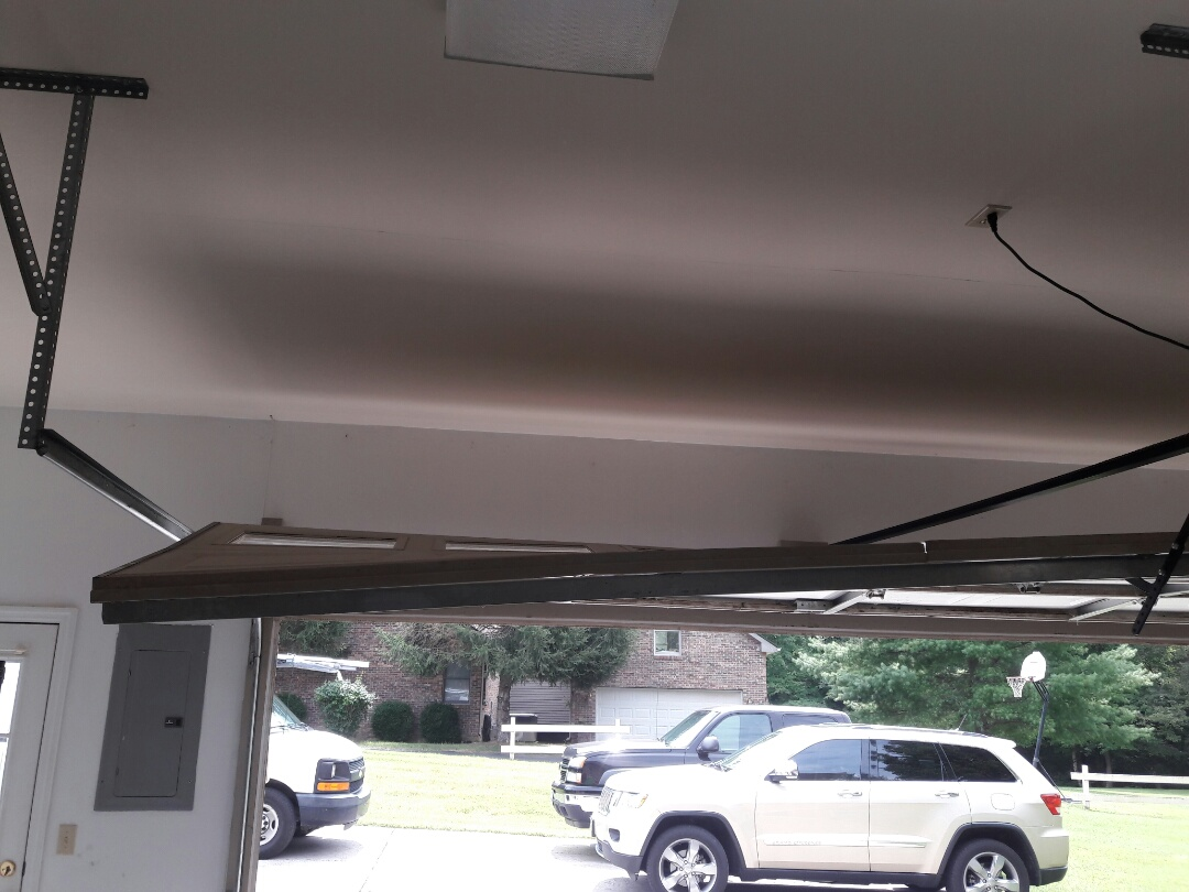Springfield, TN - put door back on track, adjusted spring, cable, and drums