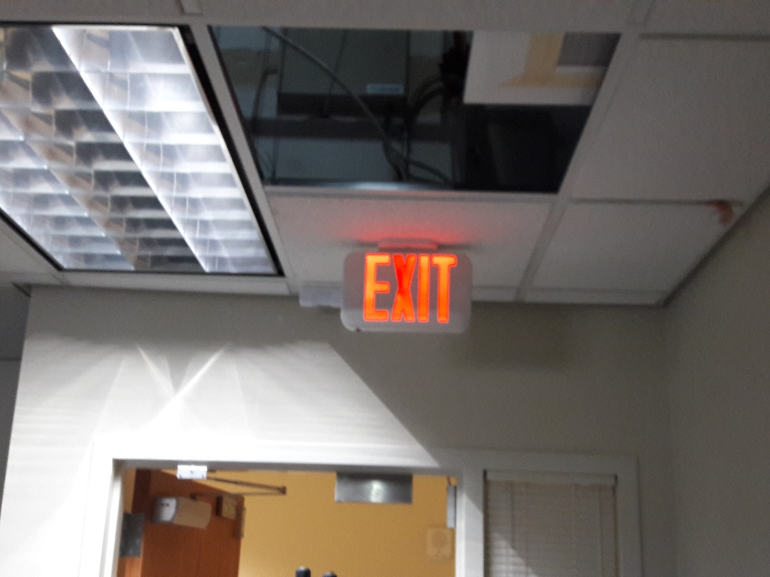Installing new exit signs. Homestead Air Reserve Base.33039