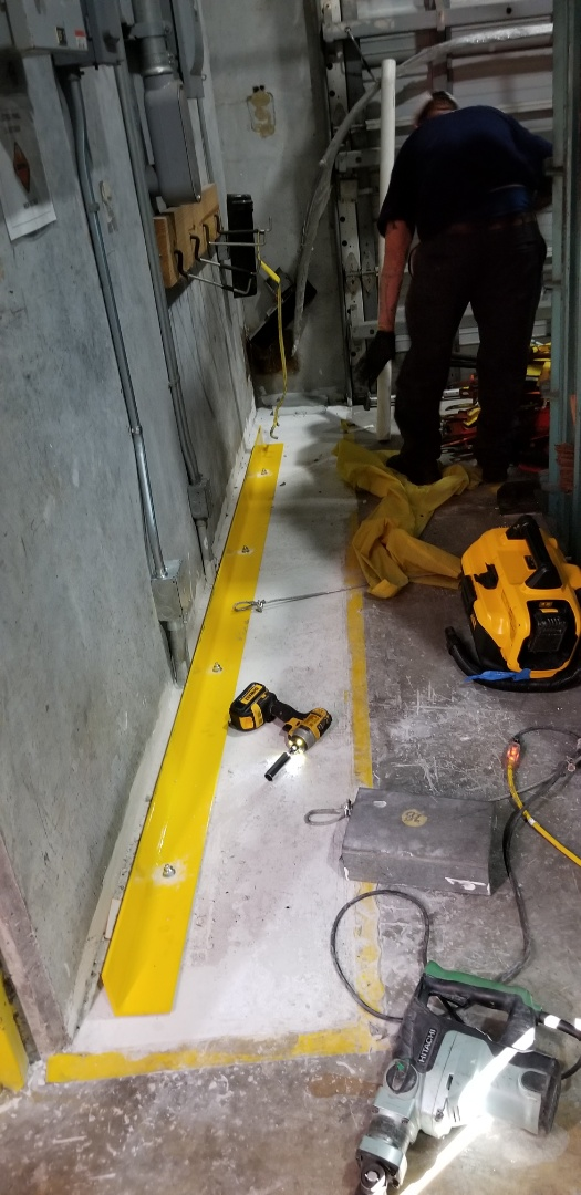 Medley, FL - Installing angle iron to protect electrical boxes from being hit by forklift