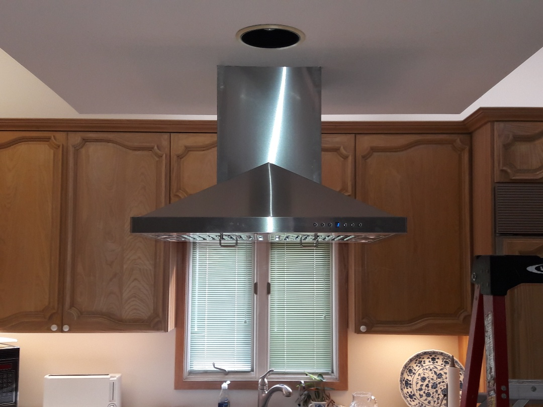 Key West, FL - Installed oven hood in kitchen ceiling. Key West Fl 33040