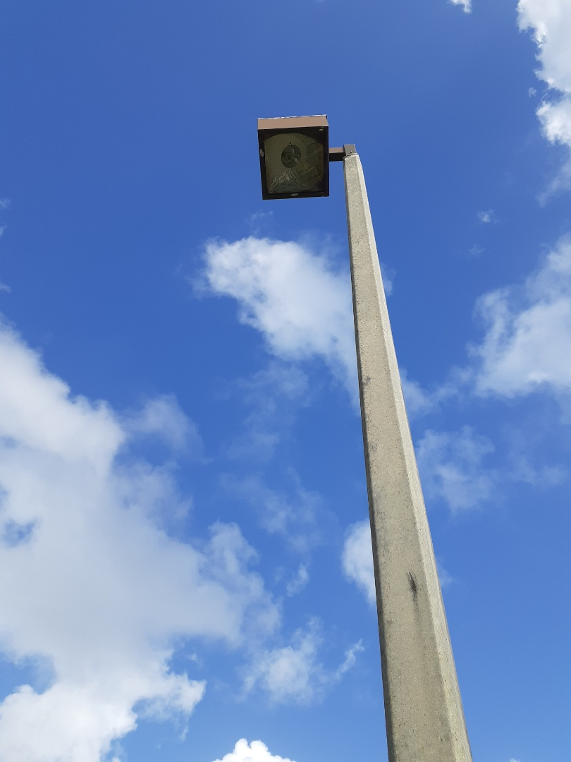 Replacing 400 watt metal halide lamps and ballast on parking light poles Ceramic Matrix Tile Weat Palm Beach Fl