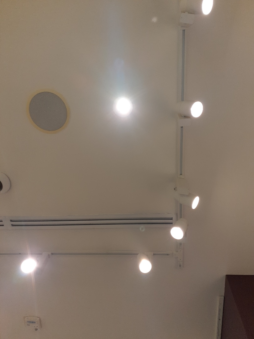 Replace recessed lighting fixtures ballast and lamps. Solstice Boutique Miami Beach Florida 33139