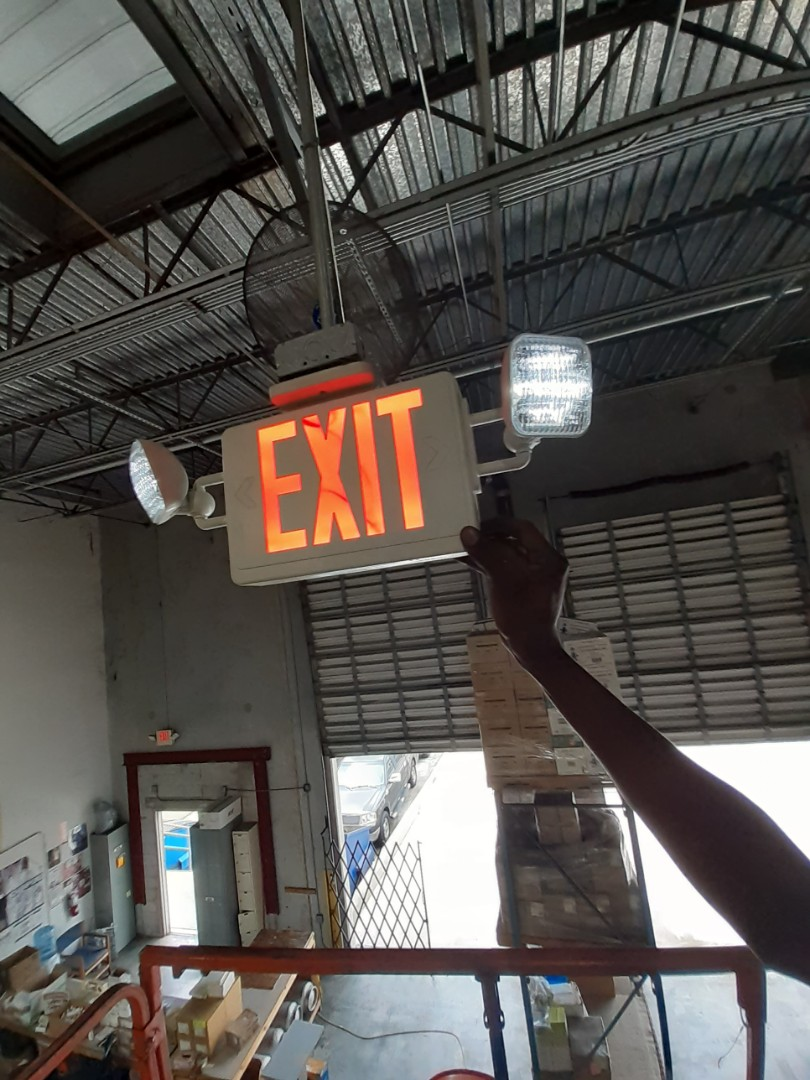 Fort Lauderdale, FL - Install emergency exit combo fixture in 26ft ceiling. Resources Services  Ft.Lauderdale Fl