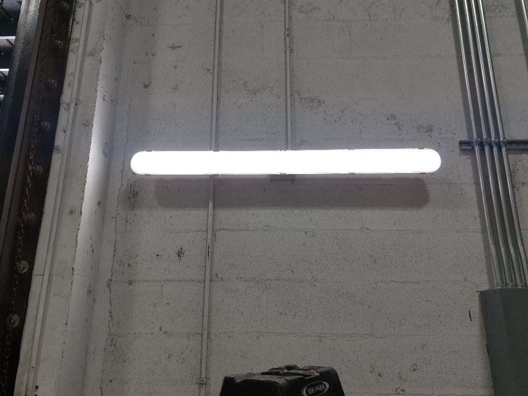 Cutler Bay, FL - Installing LED vapor proof light fixtures inside Mechanic shop. Bill Ussery Mercedes Benz.  Miami FL 33157