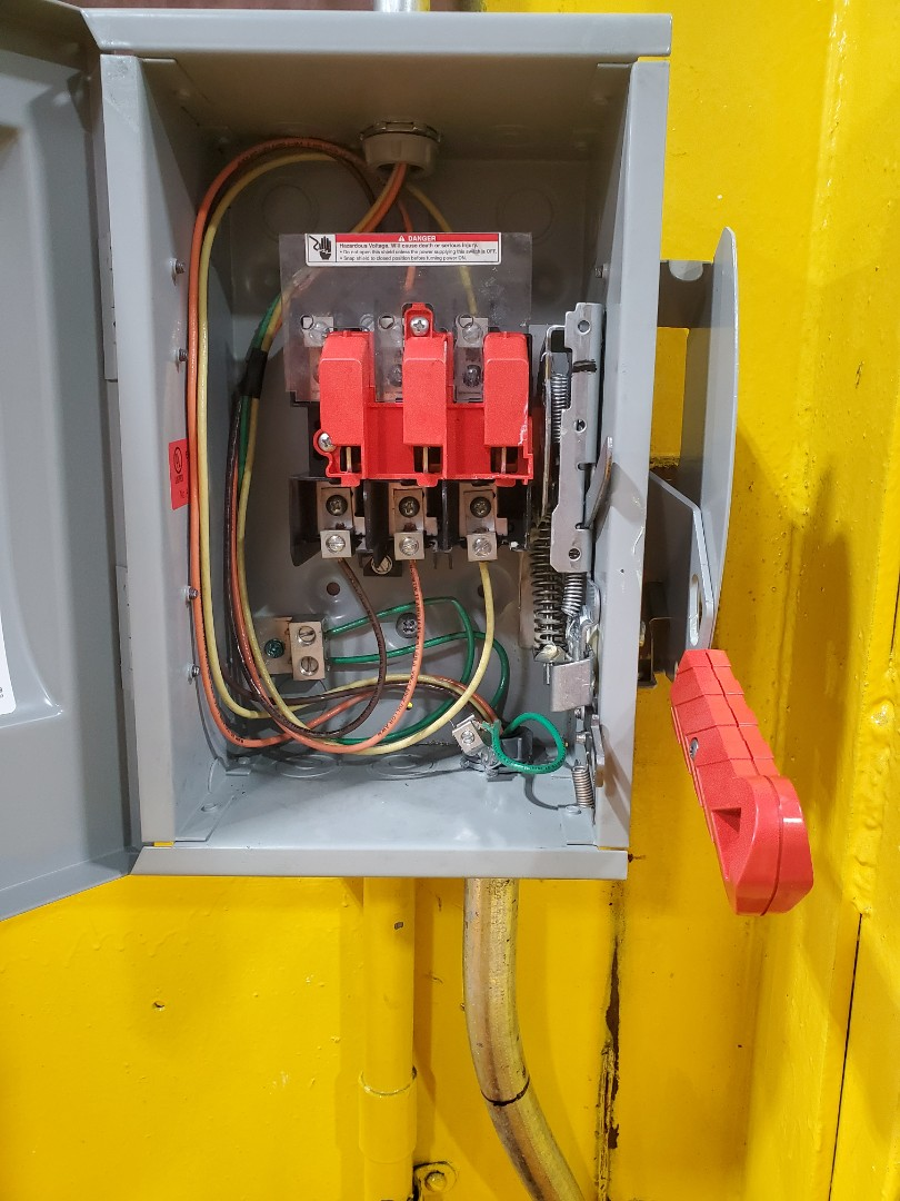 Ran wire for disconnect box/big ass fan for DHL at Miami international Airport