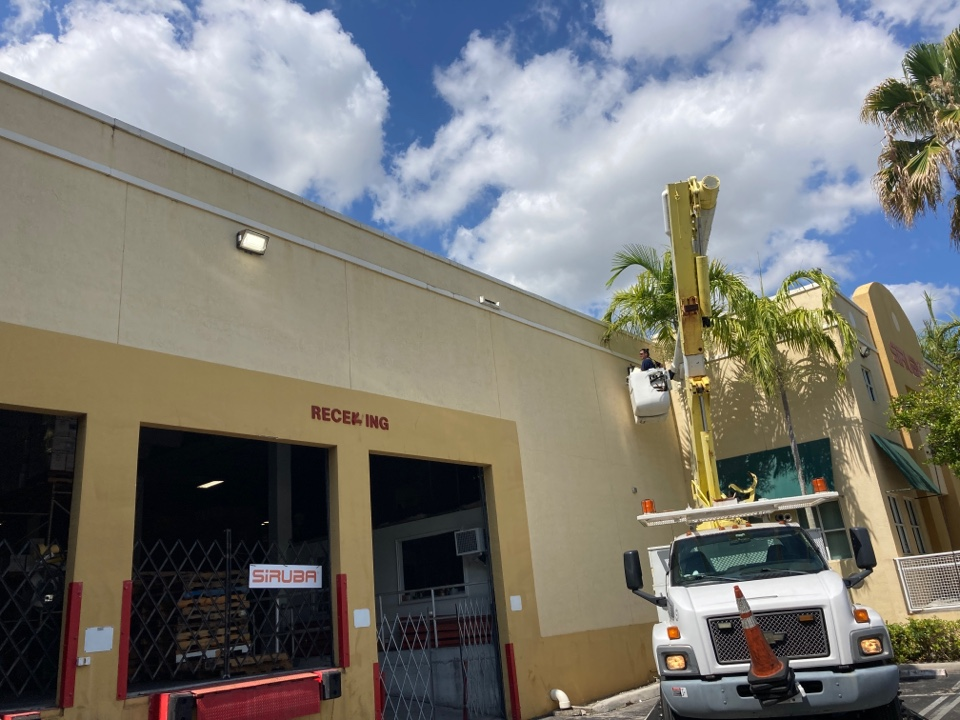 Doral, FL - Installing new led wall packs and photo cells