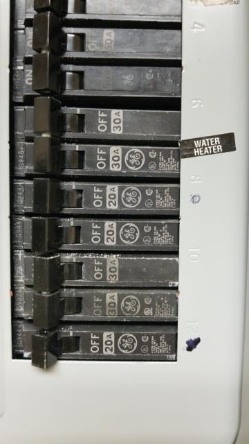 Replacing faulty hot water heater breaker.