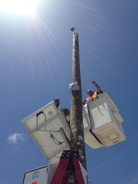 Miami Electrical Contractor installing a solar powered camera at the Port of Miami.