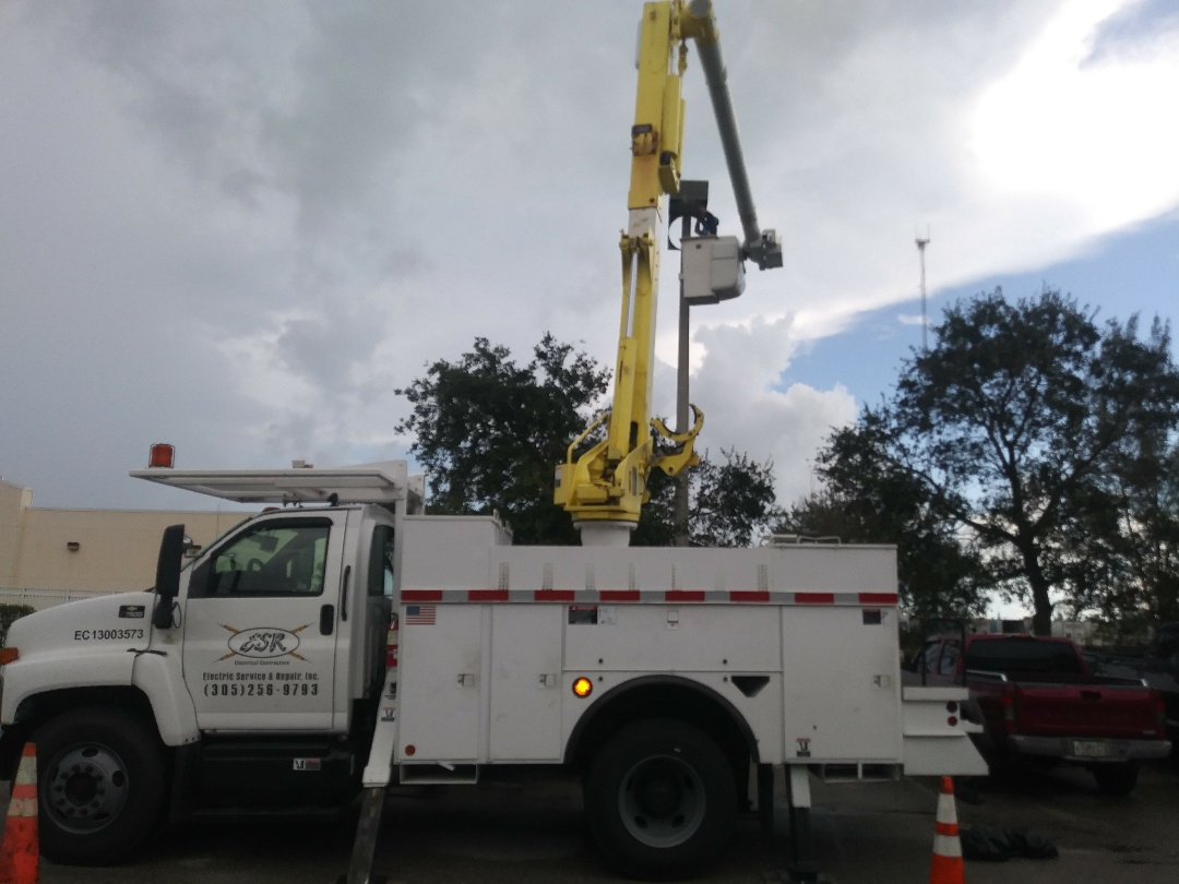 Electrician Serving Miami, FL | Retrofitting parking lot lights to high efficiency LED lighting