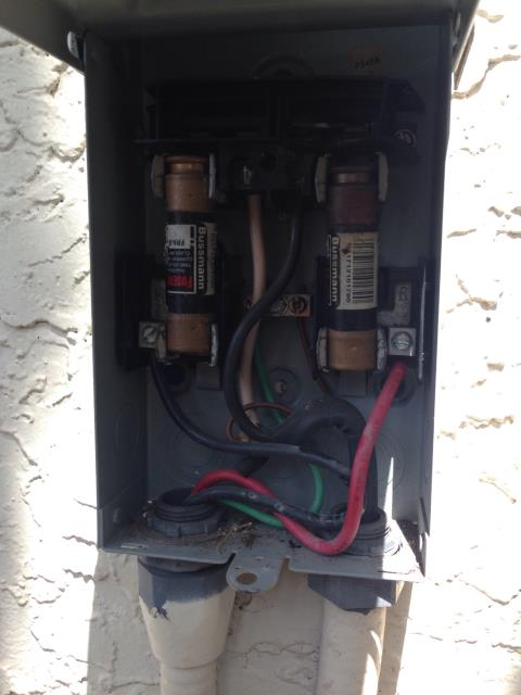 Boca Raton, FL - Electricial Contractor Boca Raton, FL|Electrician restoring air conditioning for our customers in Boca Raton, FL by repairing fused disconnect switch.