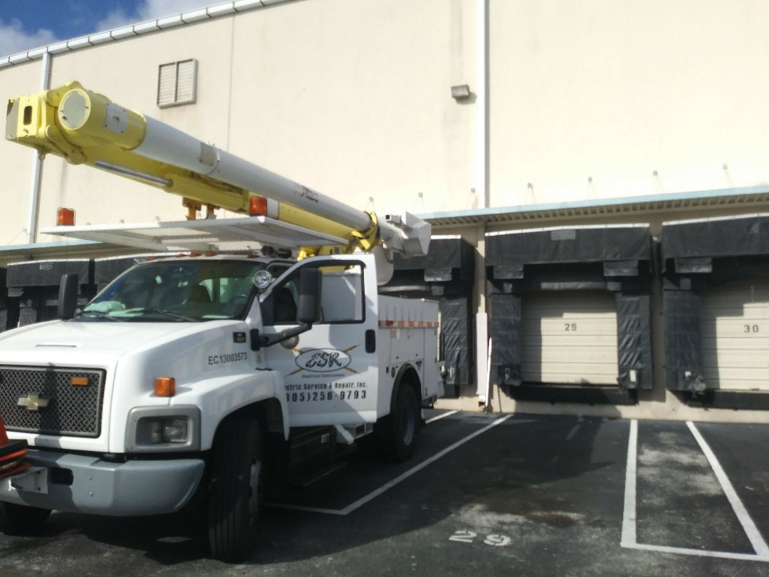 Pompano Beach, FL - Commercial Electrician in Pompano Beach, FL | Licensed and insured electrical contractor replacing exterior lighting fixtures.