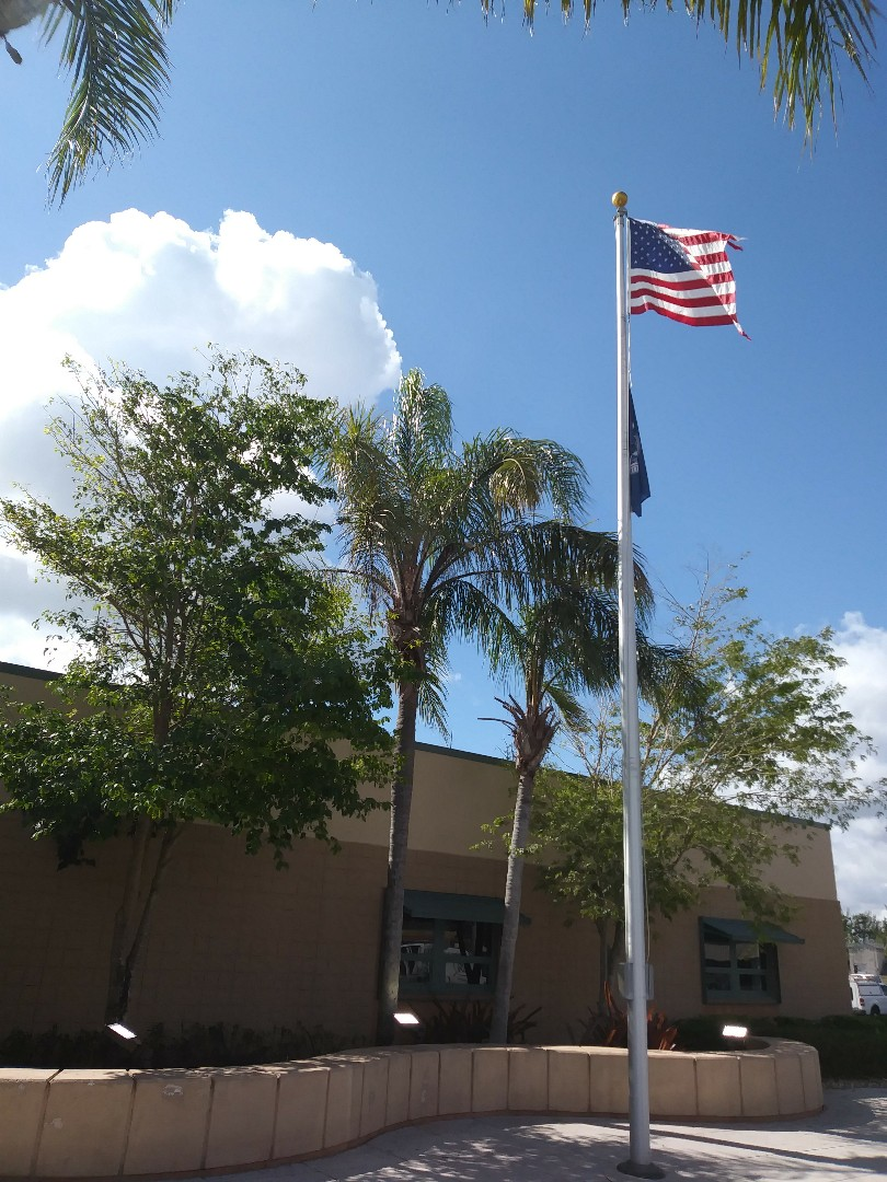 Installing Flag pole lights at the Air Force Base Homestead Fl.  For U.s Department of Homeland Security.