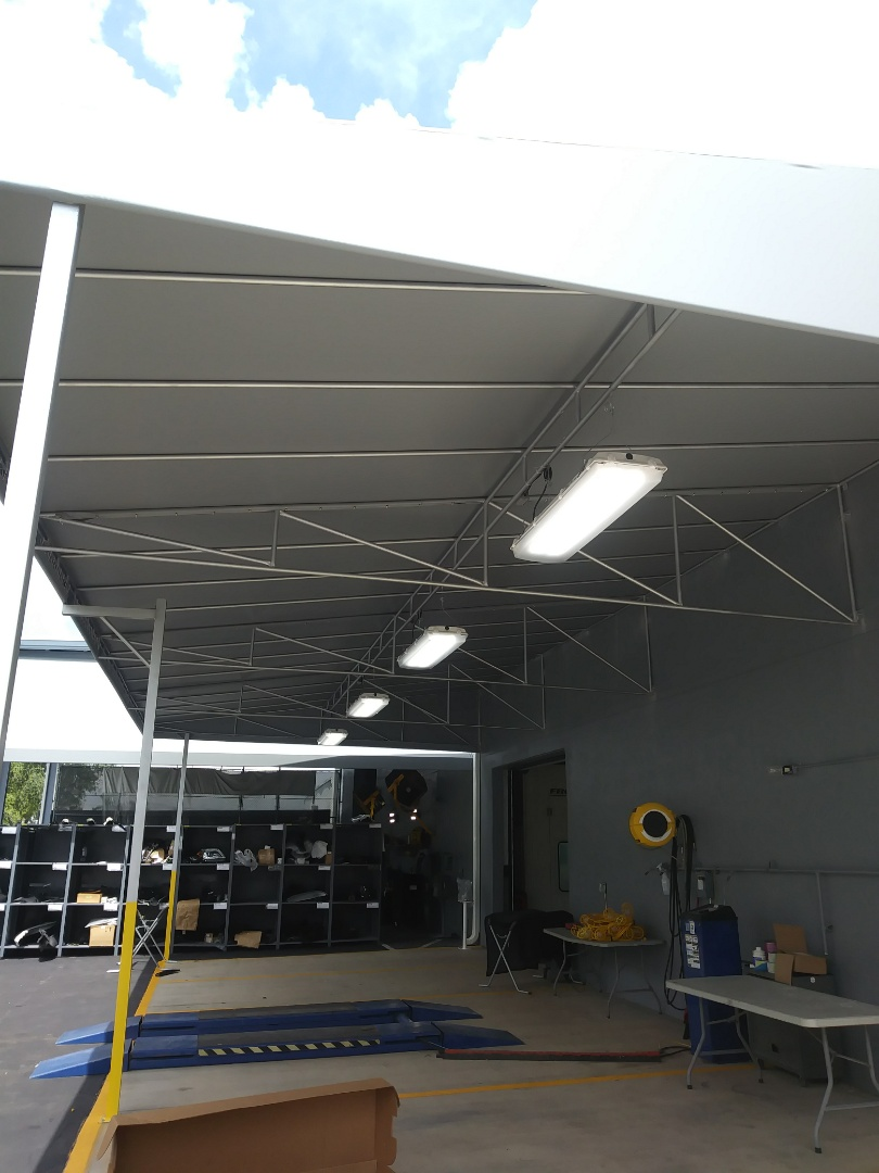 Cutler Bay, FL - Install 4 New vapor proof outdoor L.E.D light fixtures. Under canopy for Mercedes Benz Body Shop.