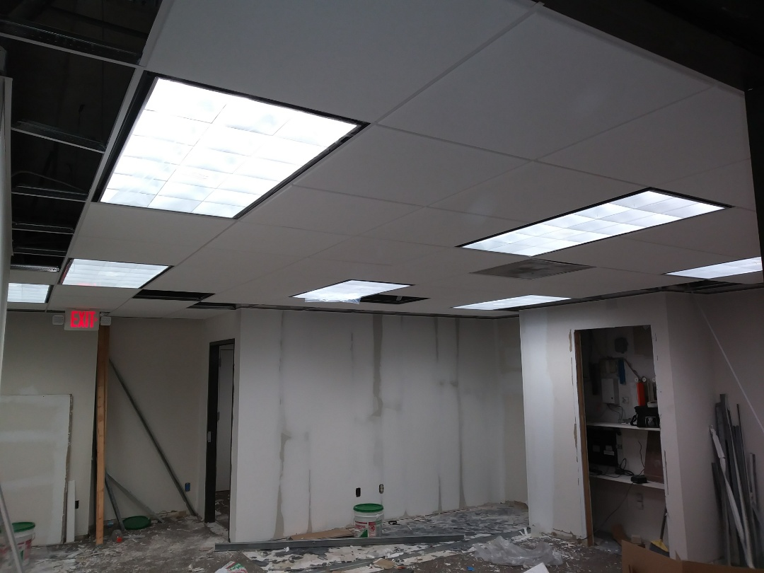 Miami, FL - Install 2x4 layin light fixtures. Also change exits lights through out space.