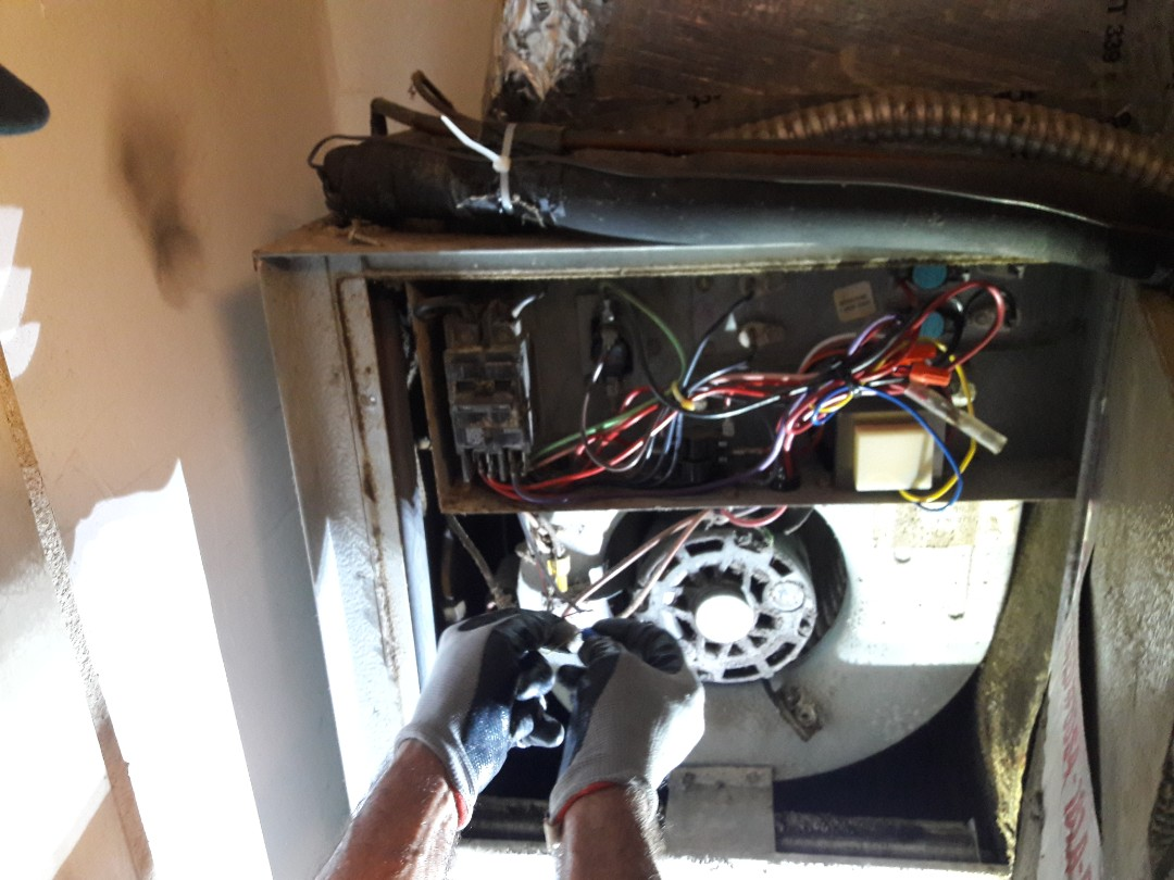 Miami, FL - Replacing thermostat wire from air handler to condenser unit. Miami,Fl 33147