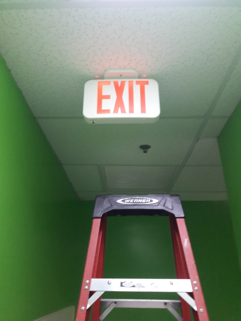 Coral Springs, FL - Commercial Electrician replacing Exit Signs through out gym as needed. You fit Gym  Coral Springs,Fl 33071