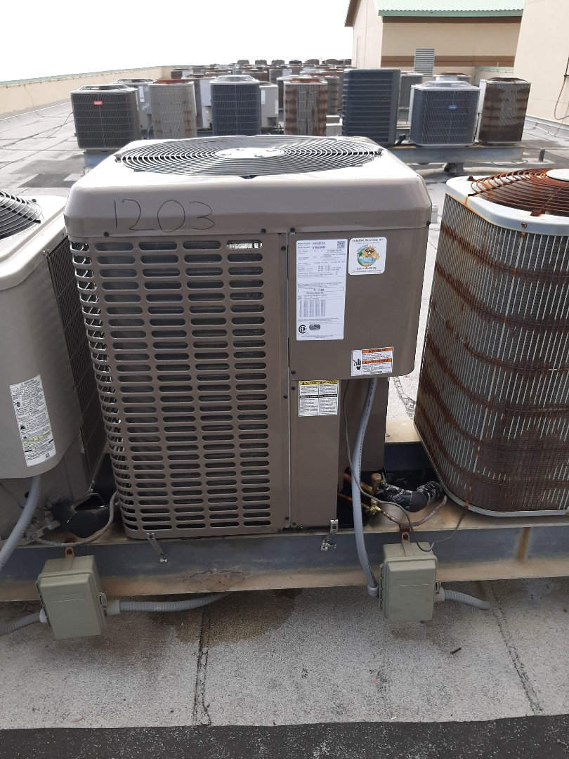 Replacing old trane air conditioning system with a brand new york Air conditioning system.