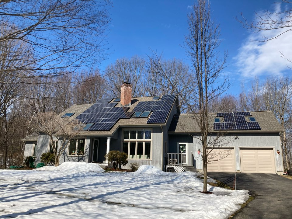 Bedford, NH - Installed new roof system and fixed leaking chimney. Call the roofing contractor Bedford homeowners can rely on. Weathered wood Landmark shingles.