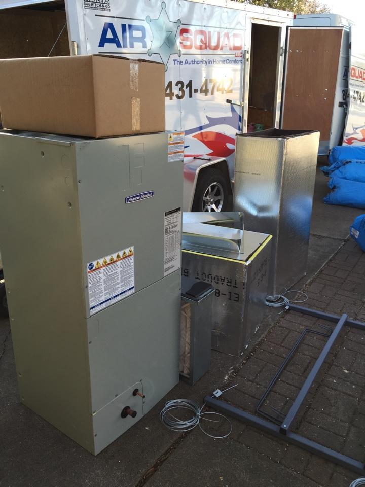 Haltom City, TX - Installing a new American Standard Silver 14 heat pump.  Using a Heat Hanger to suspend the air handler.