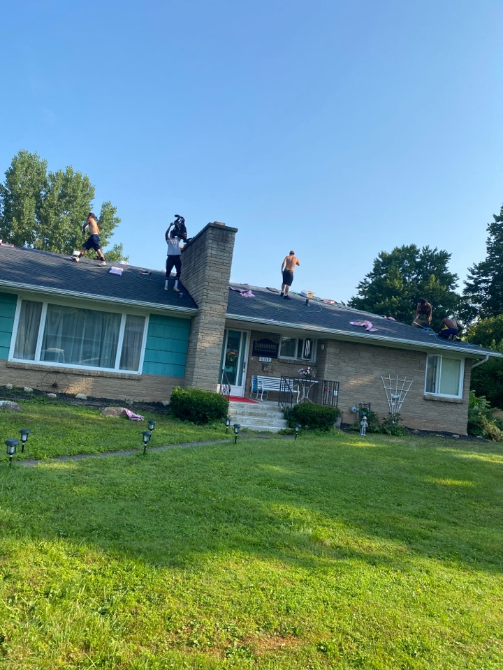 East Syracuse, NY - Shingling up this hip-style ranch we started yesterday! Installing Owens Corning duration shingles! Color is Onyx Black!