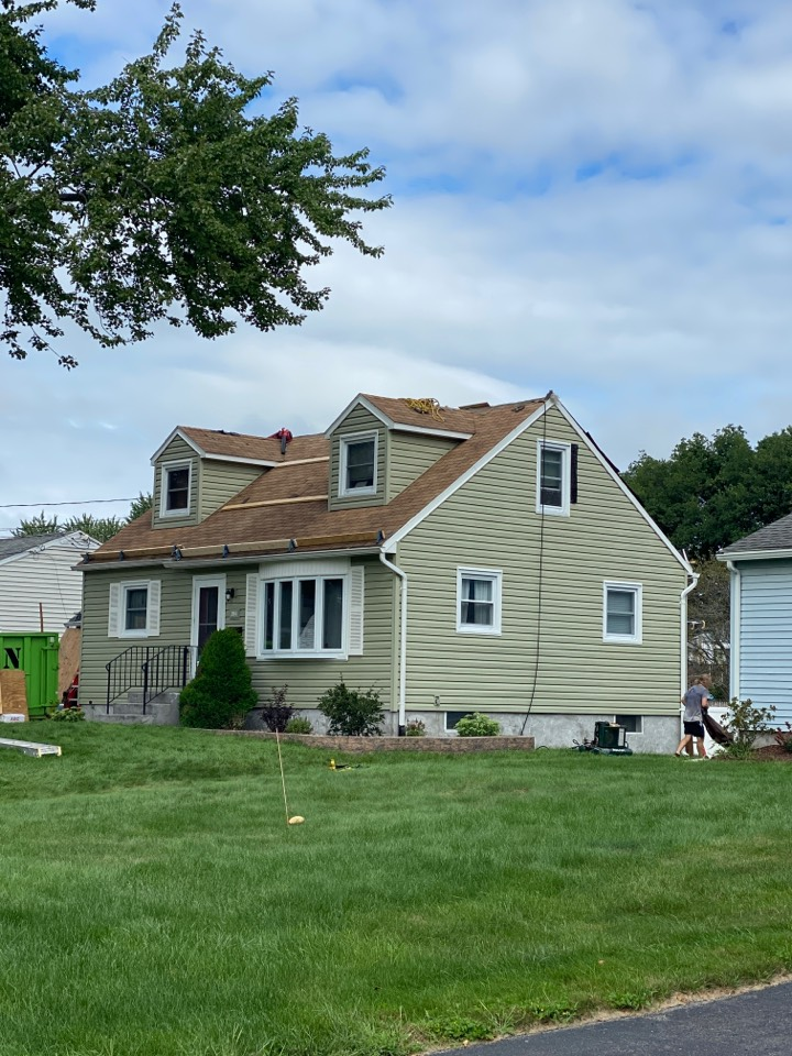 """Syracuse, NY - Full tear off and new roofing system for this cape! Complete re-deck with 1/2"""" plywood and baffles to prevent the wood from rotting again!"""