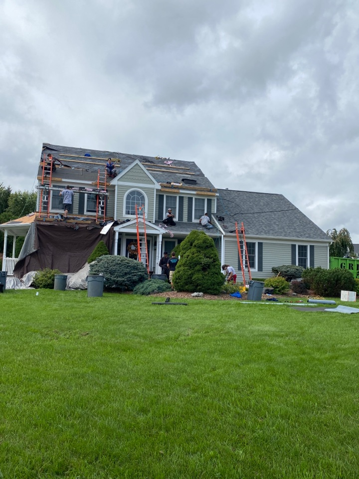 Camillus, NY - Almost done with this beautiful home in Camillus! One and a half days on this! Complete tear off and new roof system. Installed with Owens Corning product!