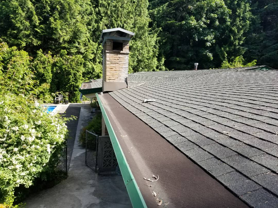 Bothell, WA - In Bothell working on a free estimate for metal Roofing with PVC gutters. Call you local roofer, State  Roofing today for a comprehensive roof evaluation.