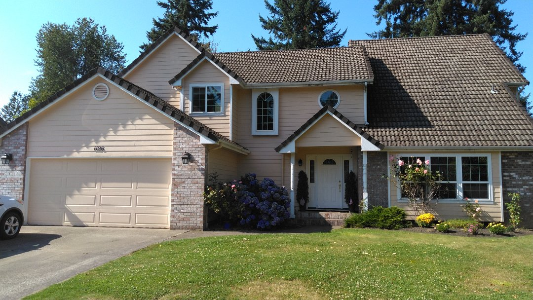 Tumwater, WA - Concrete tile roof is leaking on my customers beautiful home in her valleys. Metal valleys and our 50 year Rubber based shingles, will solve all those issues.