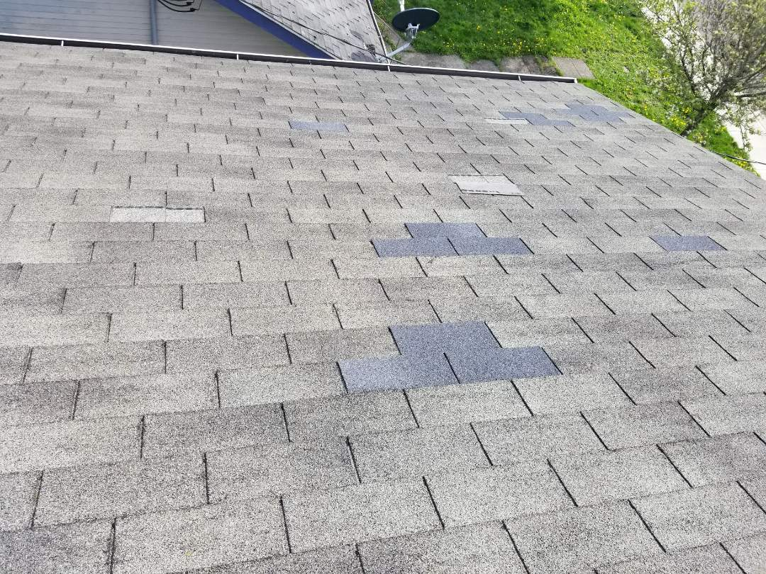 Everett, WA - Old patch work next to new missing shingles. Another reason to replace the entire roof wen signs of age show up. Repairs only work so long