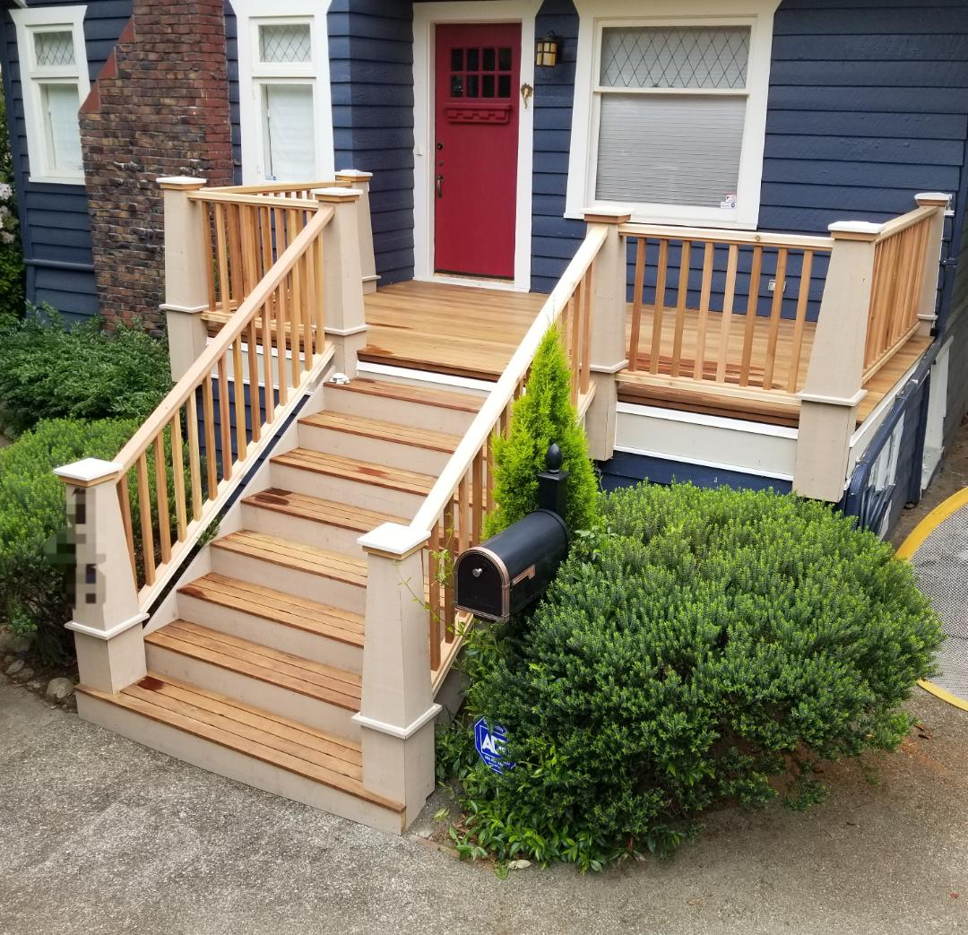 Seattle, WA - Just finished a waterproof deck with Ipe decking. Custom rails to keep with the architecture.
