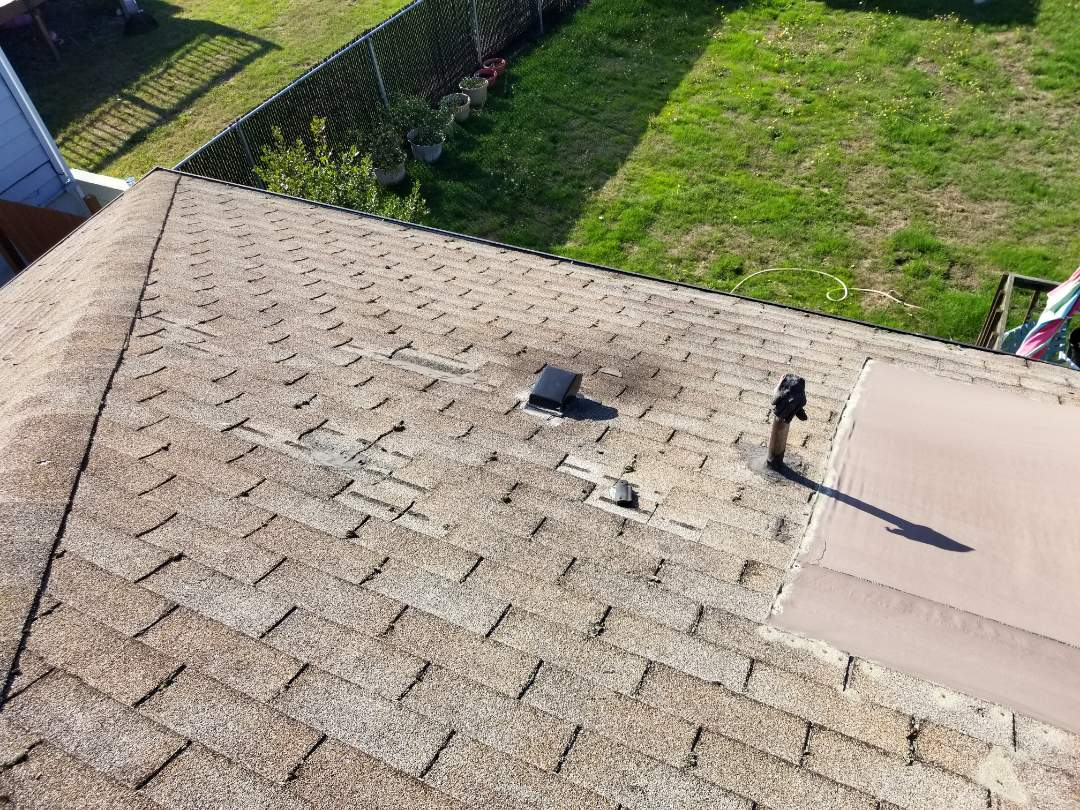 Seattle, WA - Bidding a roof replacement in Seattle. State Roofing offers affordable pricing on all kinds of roofing materials.