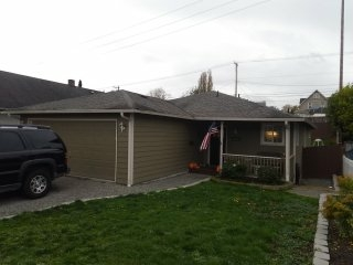 Tacoma, WA - Our customer here in Tacoma is having some leak issues. Time for one of our rubber based shingles we have to offer.