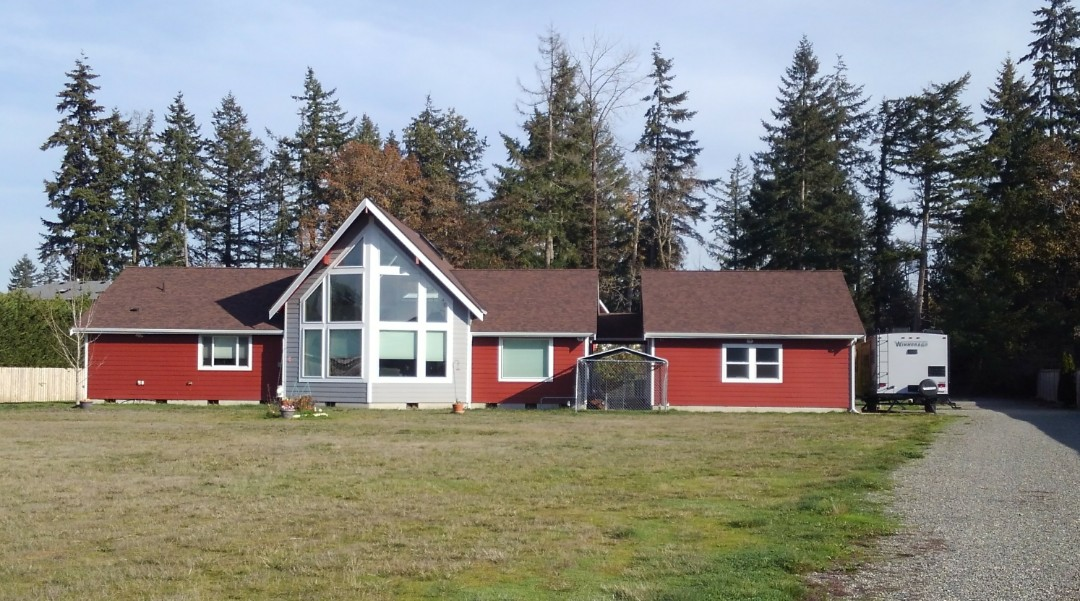 Tacoma, WA - Beautiful home here outside of Tacoma by Spanaway that we recently finished roofing. Our 50 year rubber based shingles look great but most importantly will function the right way under these trees and the windy conditions here at the base of the mountains.