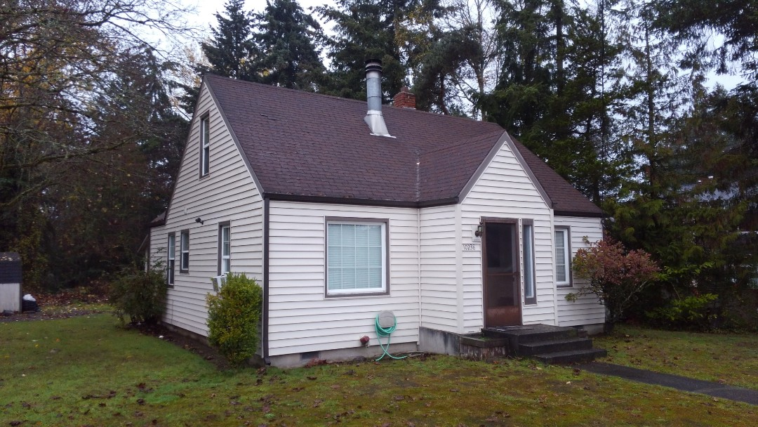 Tacoma, WA - Cute house here in Tacoma area in need of our Rubber based shingles under these trees.