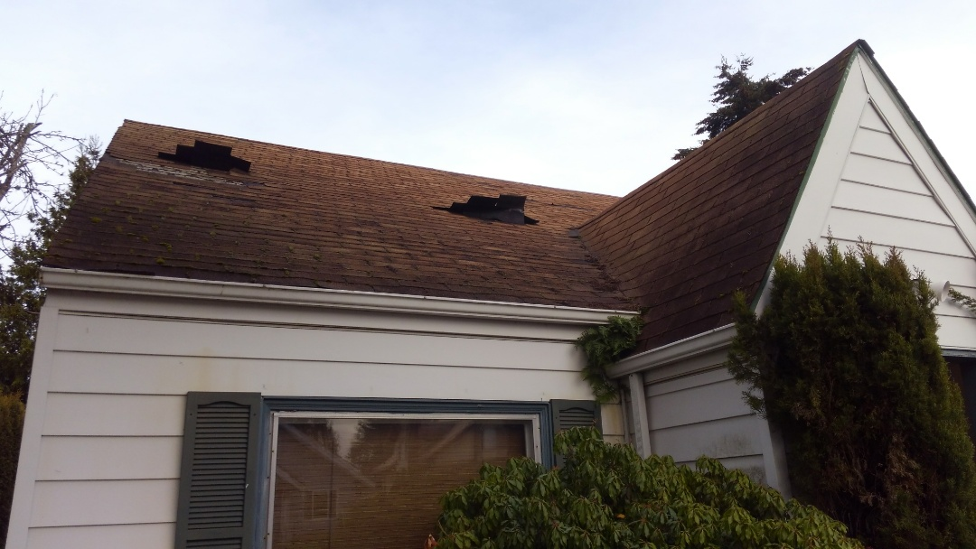 Tacoma, WA - Another wind damaged house here in Tacoma looking for our rubber based shingles that are rated to 110 mph winds. It'll look good too!