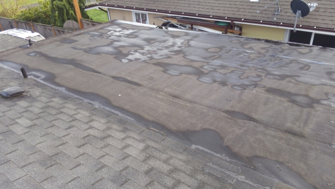 Tacoma, WA - My customer here in Lakewood needs PVC on there flat roof. We do that, and when you are ready to do the rest of your roof we will honor a repeat customer discount right from the start. Another way we always take care of our customers.