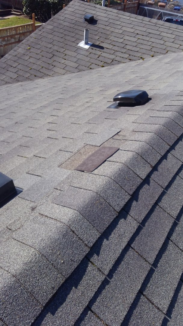 Tacoma, WA - 3-tab shingles are rated at 60 mph. As you can see the gusts must be more than that on my customers home. A 110 mph rated rubber based shingle is what I recommend.