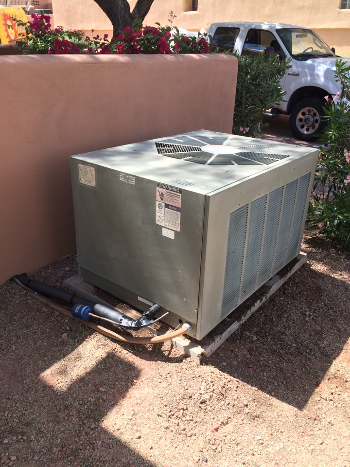 Fountain Hills, AZ - Peak performance maintenance on a RHEEM split heat pump.