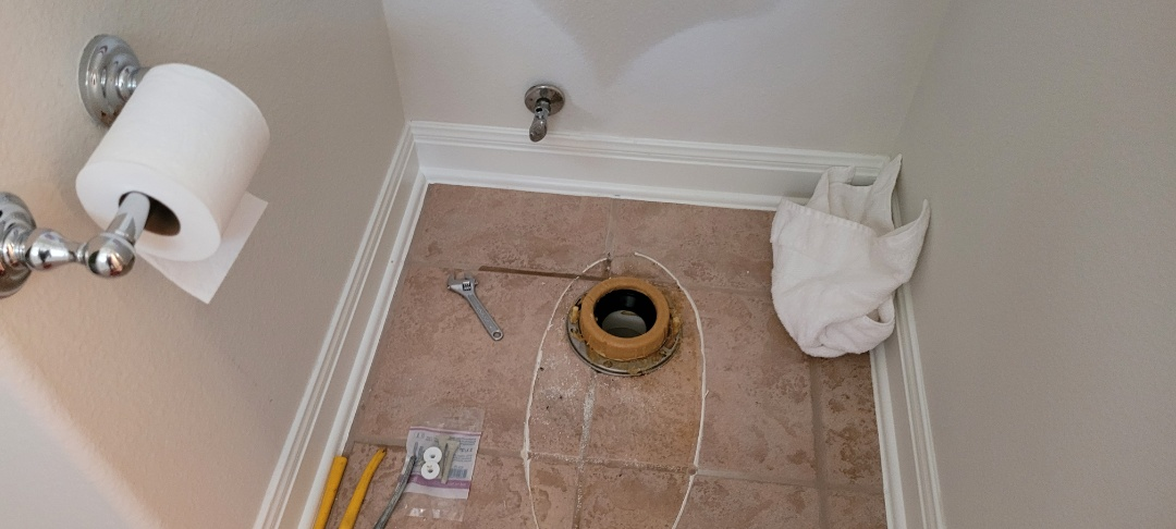 Cedar Park, TX - Lydia is working on the first toilet. Changing out two toilets and angle stop valves.  We provide new fixture installations. Toilets. Sinks. Sink faucets. Call for plumbing service.